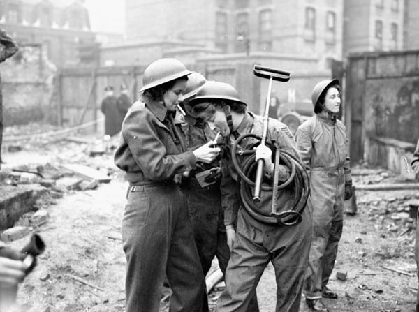 Personnel of the Canadian Women's Army Corps (C.W.A.C.) taking part in a firefighting exercise, London, England, 28 February 1943.