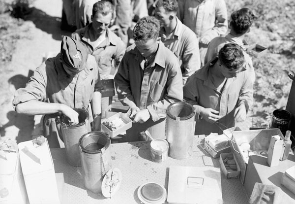 Canadian soldiers conducting field trials of mess tins and emergency rations, Penobsquis, New Brunswick, Canada, ca. 2-11 September 1942.