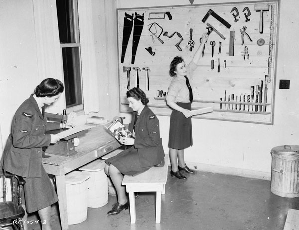 Unidentified airwomen at the opening of the Station Craft Shop, R.C.A.F. Station Rockcliffe, Ontario, Canada, 25 January 1944.