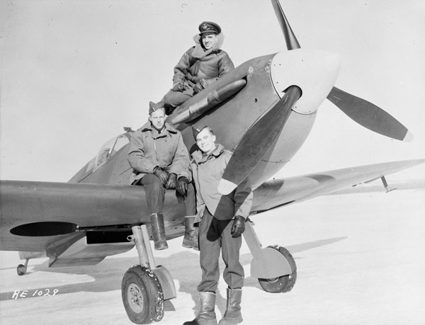 Unidentified personnel with Supermarine Spitfire V aircraft R7143 of No.13(P) Squadron, R.C.A.F., Rockcliffe, Ontario, Canada, 14 January 1944.