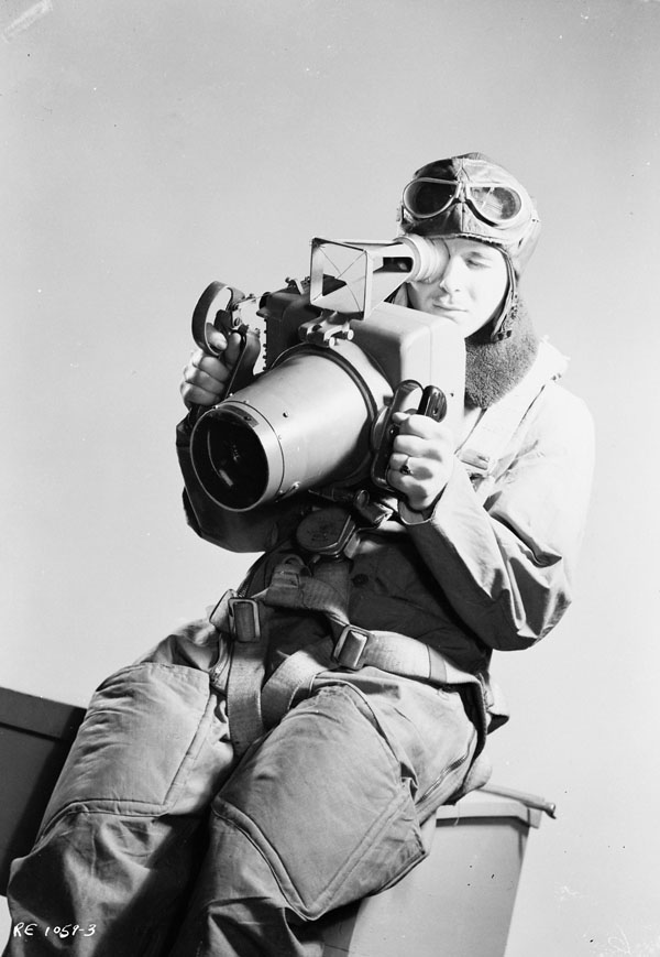 Unidentified airman demonstrating an F24 aerial camera, R.C.A.F. Station Rockcliffe, Ontario, Canada, 26 January 1944.