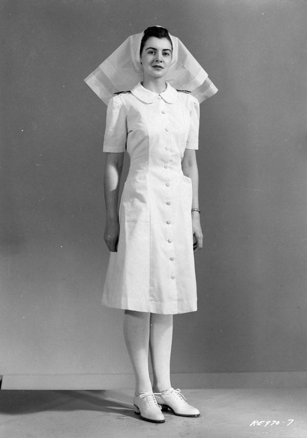 Unidentified nursing sister modelling a nursing sister's uniform, R.C.A.F. Station Rockcliffe, Ontario, Canada, 18 December 1943.