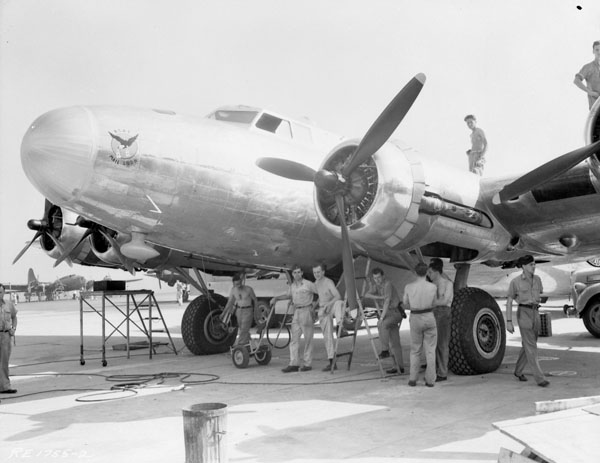 Unidentified personnel with Boeing Fortress IIA aircraft 9205 of No.168(HT) Squadron, Royal Canadian Air Force (R.C.A.F.), Rockcliffe, Ontario, Canada, 8 August 1944.