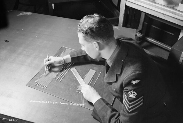 Processing of prints for tri-metrogon mapping, No.1 Photographic Establishment, R.C.A.F., Rockcliffe, Ontario, Canada, 1 March 1945.