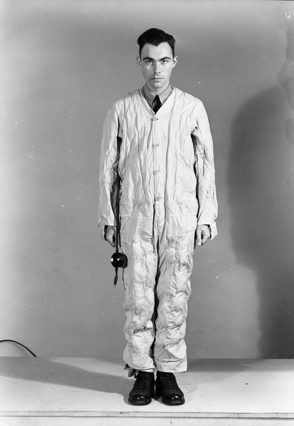 Unidentified airman modelling a heated flying suit, Test and Development Establishment, R.C.A.F. Station Rockcliffe, Ontario, Canada, 14 September 1944.