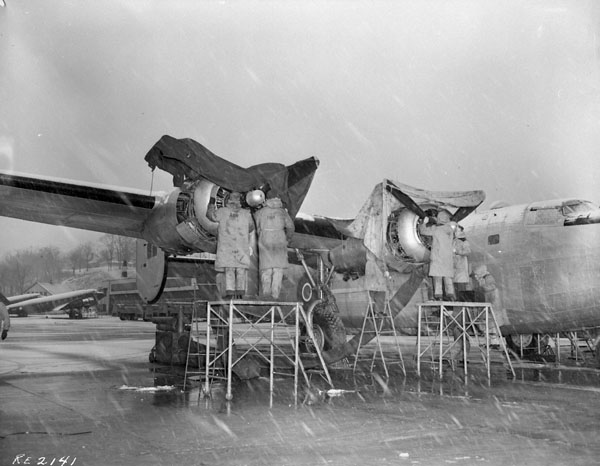 Groundcrew servicing Consolidated Liberator VI T aircraft 570 of No. 168 (HT) Squadron, RCAF.