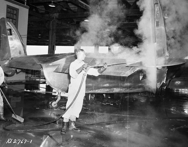 Groundcrew stripping paint from a Lockheed Lodestar aircraft, R.C.A.F. Station Rockcliffe, Ontario, Canada, 13 July 1945.