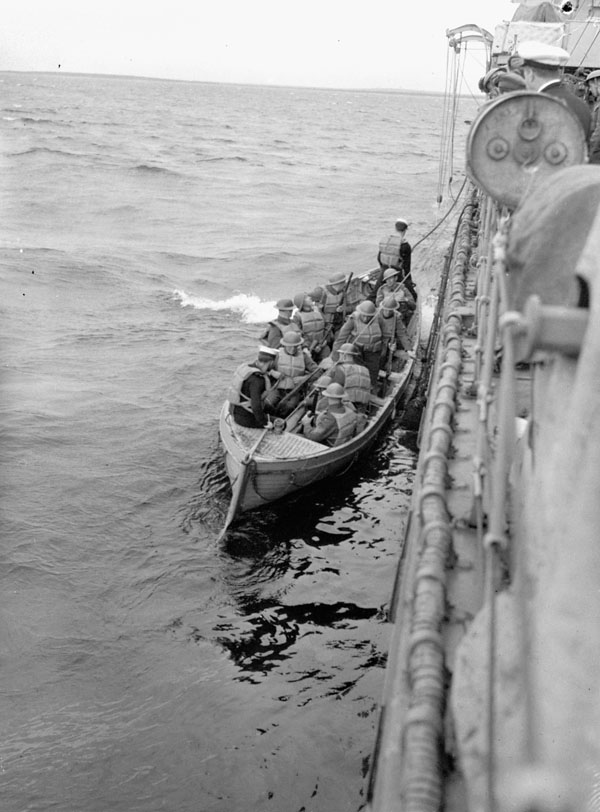 Personnel and supplies of the 1st Battalion, The Black Watch (Royal Highland Regiment) of Canada, going ashore from H.M.C.S. OTTAWA, Botwood, Newfoundland, 22 June 1940.