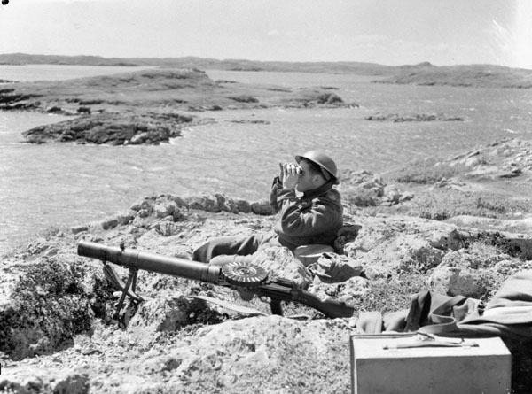 Unidentified infantryman of the 1st Battalion, The Black Watch (Royal Highland Regiment) of Canada, manning a machine gun position, Botwood, Newfoundland, 22 June 1940.