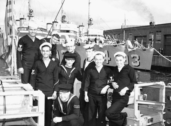 Group of U.S. Navy and Royal Navy ratings who took part in the transfer of destroyers  to the Royal Navy and Royal Canadian Navy, Halifax, Nova Scotia, Canada,  ca. 23-24 September 1940.