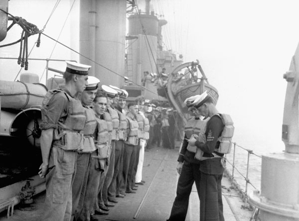 Ratings mustered along the starboard side of H.M.C.S. ASSINIBOINE at sea, ca. September 1940.