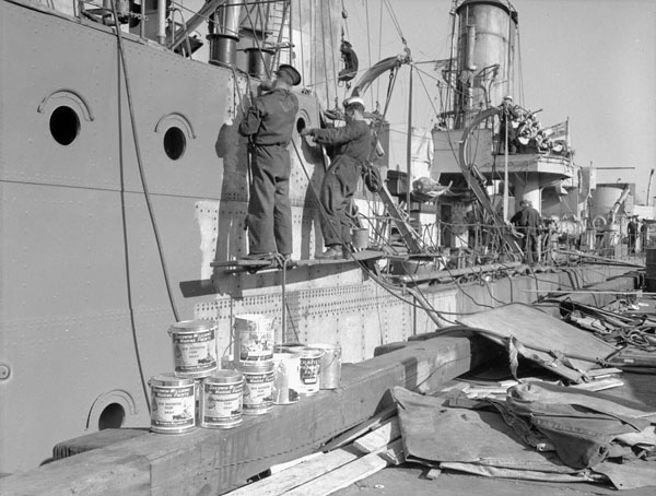 Unidentified naval ratings painting the destroyer H.M.C.S. RESTIGOUCHE, Halifax, Nova Scotia, Canada, October 1940.