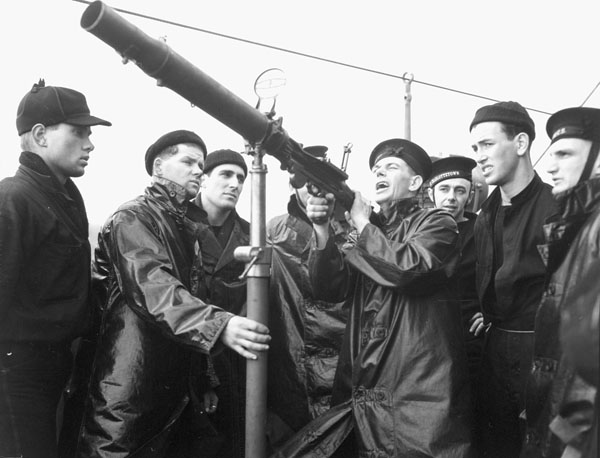 Petty Officer Williams instructing ratings in the operation of a Lewis machine gun aboard H.M.C.S. PRINCE DAVID, Halifax, Nova Scotia, Canada, January 1941.