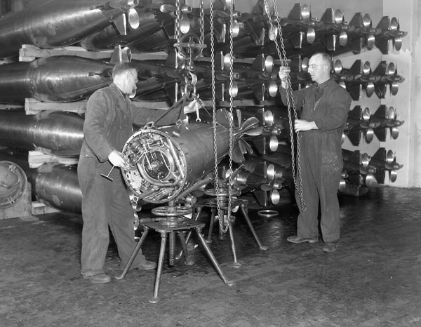 Personnel servicing torpedoes at the Royal Canadian Navy (R.C.N.) Torpedo Depot, Halifax, Nova Scotia, Canada, March 1941.