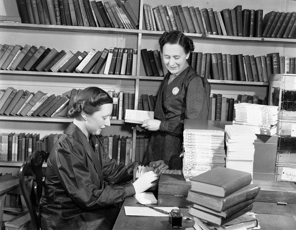 Librarians processing books, H.M.C.S. STADACONA, Halifax, Nova Scotia, Canada, March 1941.