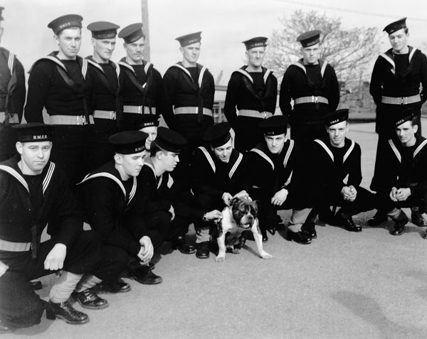Unidentified ratings with their mascot Buddy at the Royal Canadian Navy Gunnery School, Halifax, Nova Scotia, Canada, October 1941.