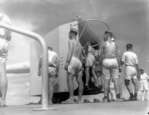 """Crew of """"Y"""" six-inch gun aboard H.M.C.S. PRINCE HENRY carrying out a sub-calibre shoot off Bermuda, October 1941."""
