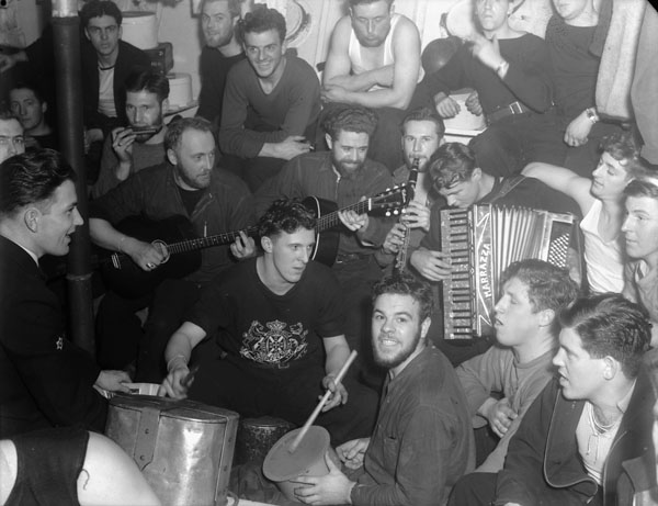 A singsong in the seamens' mess aboard H.M.C.S. ST LAURENT off Iceland, January 1942.