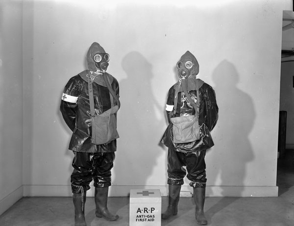 Personnel of the Royal Canadian Navy Air Raid Precaution (ARP) squad wearing anti-gas clothing, Halifax, Nova Scotia, Canada, 4 November 1942.