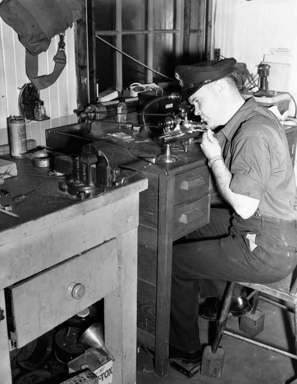 A  Chief Electrical Artificer operating a jeweller's lathe in the Electrical Artificers' Workshop, H.M.C. Dockyard, Halifax, Nova Scotia, Canada, 18 November 1942.