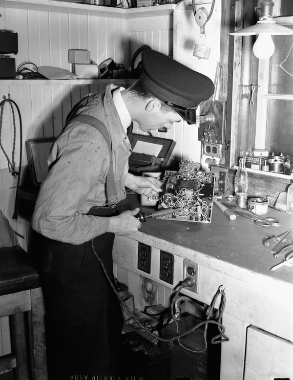 An Electrical Artificer working on a radio set in the Electrical Artificers' Workshop, H.M.C. Dockyard, Halifax, Nova Scotia, Canada, 18 November 1942.