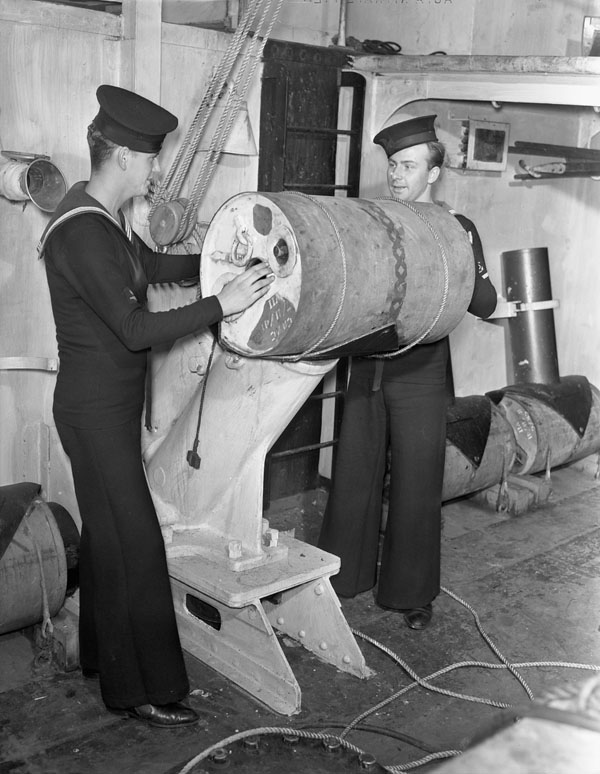 Able Seaman George Howard (left) and Leading Torpedoman Charles Skeggs of H.M.C.S. OAKVILLE, who took part in the sinking of the German submarine U-94 on 28 August. Halifax, Nova Scotia, Canada, 17 October 1942.