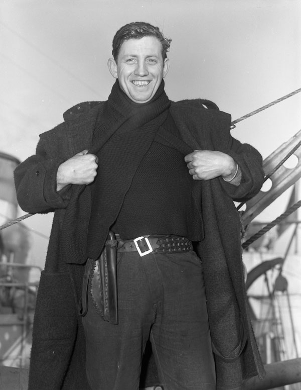 Able Seaman J.P. Clements, who is wearing a woolen scarf supplied by The Canadian Red Cross Society, Halifax, Nova Scotia, Canada, 5 February 1943.