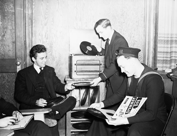 Personnel listening to records at the North End Services Canteen, Halifax, Nova Scotia, Canada, 6 February 1943.