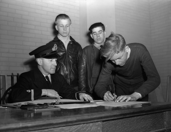 Boys signing application forms to join the Nelson Sea Cadet Corps, Halifax, Nova Scotia, Canada, 23 March 1943.