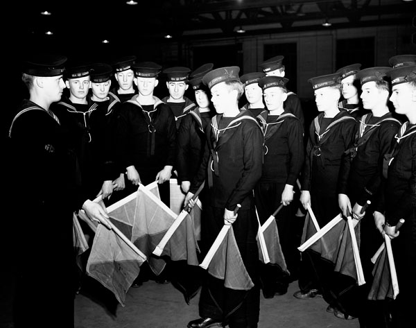 Cadets of the Nelson Sea Cadet Corps learning signalling with semaphore flags, Halifax, Nova Scotia, Canada, 23 March 1943.