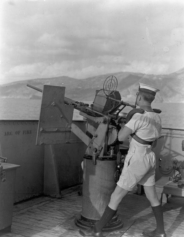 Able Seaman Joe Nantais manning an Oerlikon 20mm. anti-aircraft gun aboard H.M.C.S. PRINCE DAVID off Kithera, Greece, 16 September 1944.