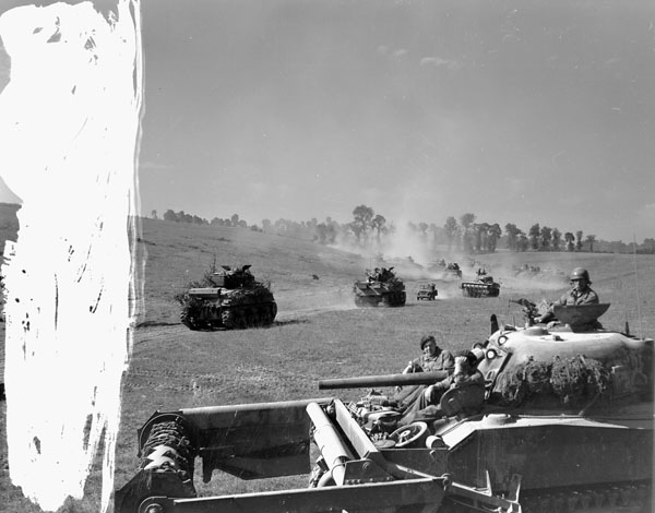 Sherman tanks of The Fort Garry Horse taking part in Operation TRACTABLE moving out near Brettevile-le-Rabet, France, 14 August 1944.