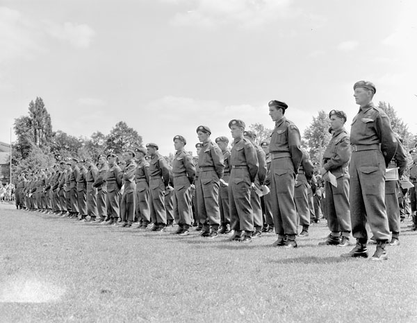 Infantrymen of The Lake Superior Regiment (Motor) attending a memorial service for comrades who were killed in Northwest Europe. Hengelo, Netherlands, 17 June 1945.