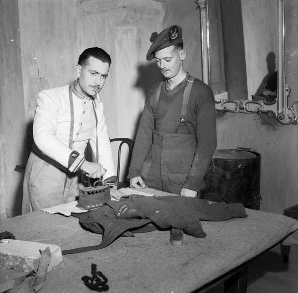 Leo Burattini pressing the uniform of Private D.S. McKinnel of the Seaforth Highlanders of Canada at the Monastery Inn, a Salvation Army rest centre for the 2nd Canadian Infantry Brigade. Ortona, Italy, 14 February 1944.