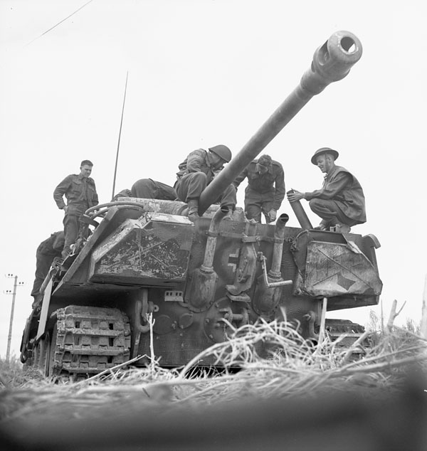 Infantrymen of the 7th Canadian Infantry Brigade examining a disabled German PzKpfW V Panther tank, Authie, France, 9 July 1944.