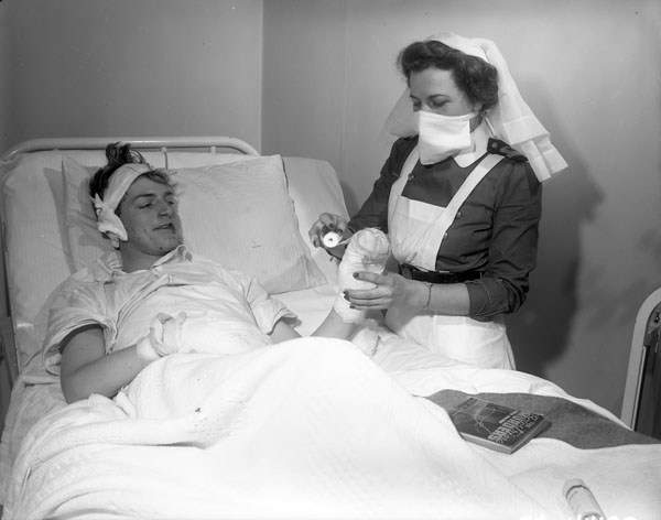 Leading Seaman H.H. Nicolle, a victim of the Knights of Columbus Hostel fire, in the Royal Canadian Navy (R.C.N.) Hospital, St., John's, Newfoundland, 27 December 1942.