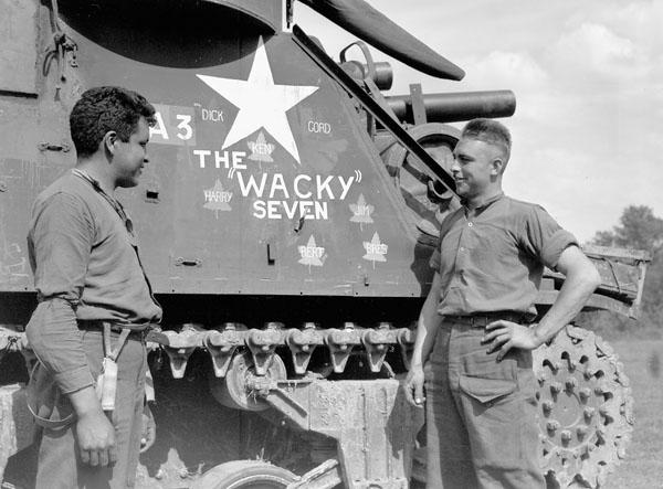 Gun crew with the Priest M-7 self-propelled gun A3