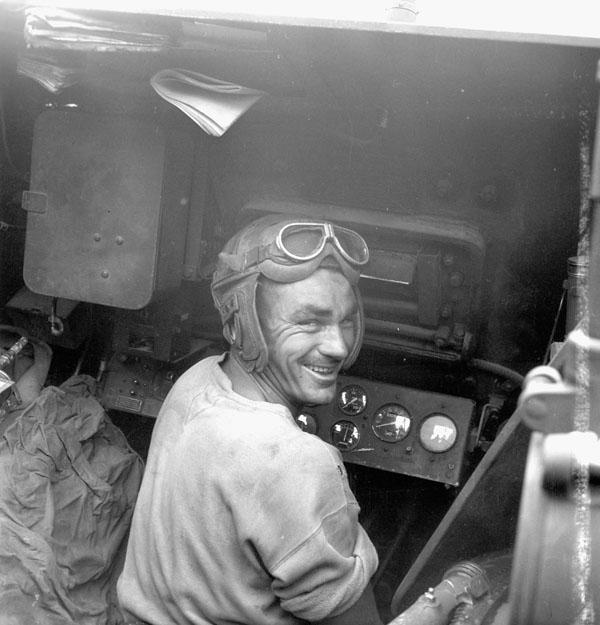 Gunner C.F. Bolderstone in a Priest M-7 self-propelled gun of the 14th Field Regiment, Royal Canadian Artillery (R.C.A.), France, 20 June 1944.