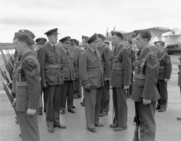Air Vice-Marshal A. Earl Godfrey inspecting personnel of No.116 (BR) Squadron, Royal Canadian Air Force (R.C.A.F.), Botwood, Newfoundland, September 1943.