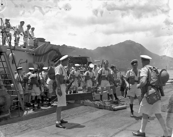 Landing party disembarking from H.M.C.S. PRINCE ROBERT during the liberation of Hong Kong, ca. 30 August 1945.