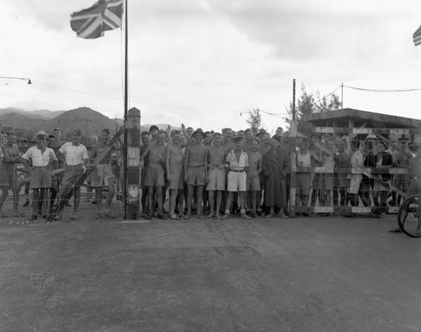Canadian and British prisoners-of-war awaiting liberation by the landing party from H.M.C.S. PRINCE ROBERT, Hong Kong, ca. 30 August 1945.