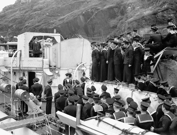 Commodore L.W. Murray congratulating the Ship's Companies of H.M.C. Ships SKEENA and WETASKIWIN  for sinking the German submarine U-588 on 31 July. St. John's, Newfoundland, 4 August 1942.