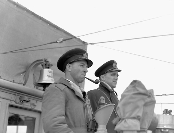 Officers on the bridge of the corvette H.M.C.S. VILLE DE QUEBEC, Lauzon, Québec, Canada, 1942.