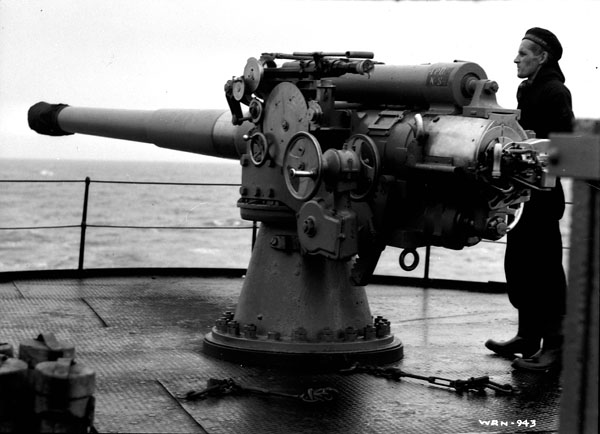 Gunner with gun aboard an unidentified defensively equipped merchant ship (DEMS), 1943.
