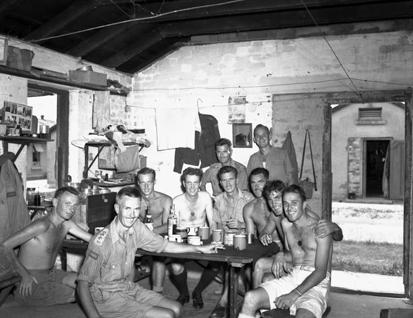 Naval personnel from the auxiliary anti-aircraft ship H.M.C.S. PRINCE ROBERT visiting liberated Canadian prisoners-of-war at Shamshuipo Camp, Hong Kong, September 1945.