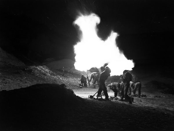 Mortars of the 1st Canadian Corps firing at night, Italy, 6 April 1944.