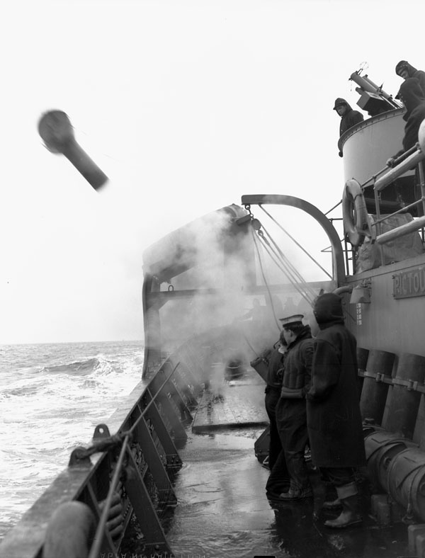 Firing of a depth charge from the corvette H.M.C.S. PICTOU at sea, March 1942.