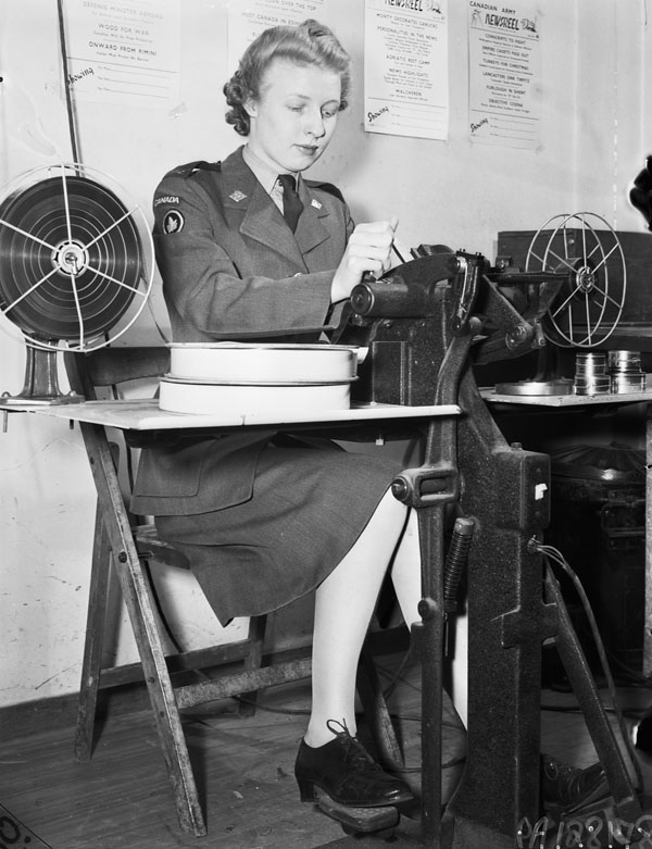 Private Marjorie Cox of the Canadian Army Film and Photo Unit splicing film, Merton Park Studios, London, England, 19 December 1944.