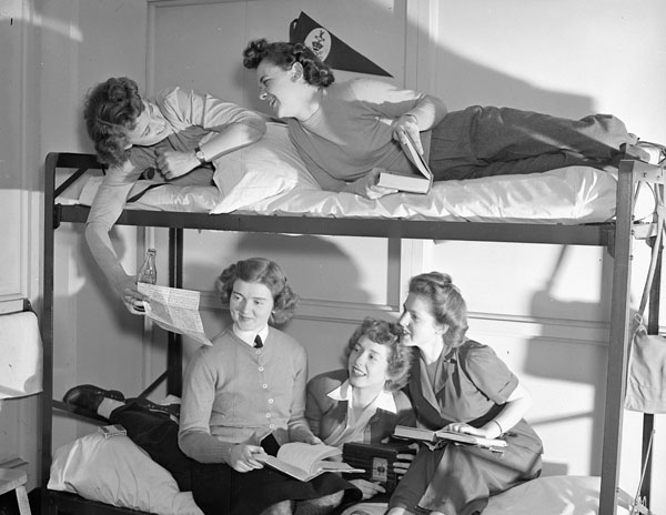 Personnel of the Women's Royal Canadian Naval Service (W.R.C.N.S.) in a dormitory, Halifax, Nova Scotia, Canada, May 1943.