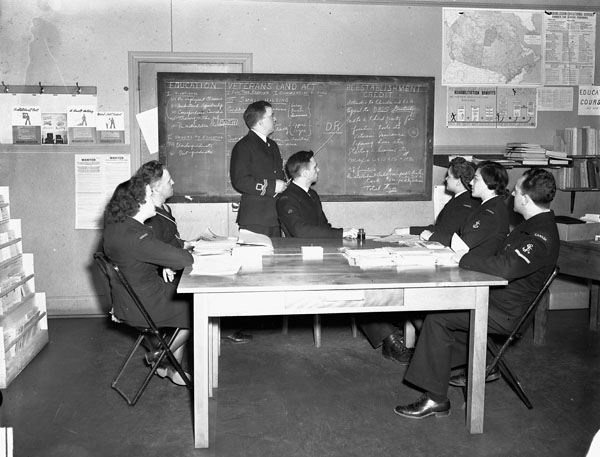 Rehabilitation lecture for Women's Royal Canadian Naval Service (W.R.C.N.S.) and Royal Canadian Naval Volunteer Reserve (R.C.N.V.R.) personnel preparing for demobilization, Ottawa, Ontario, Canada, 30 November 1945.